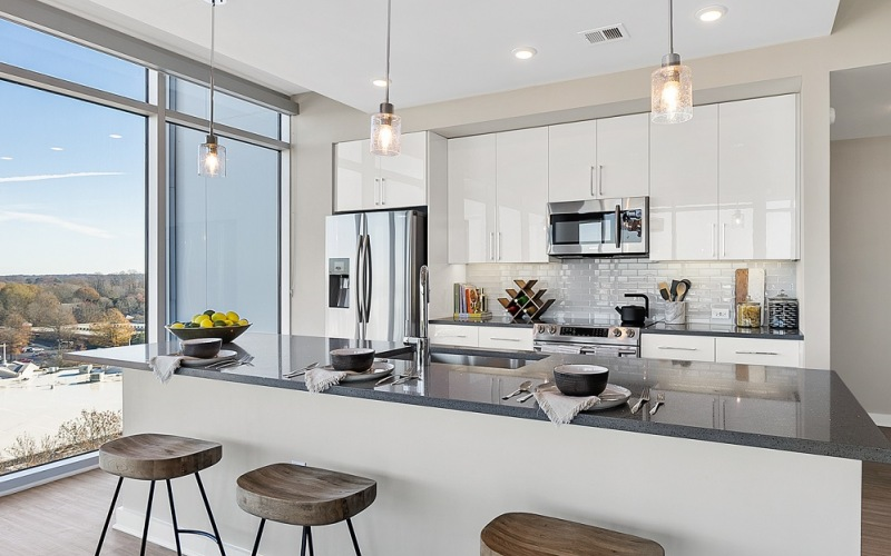 Kitchen with Island and Floor to Ceiling Windows