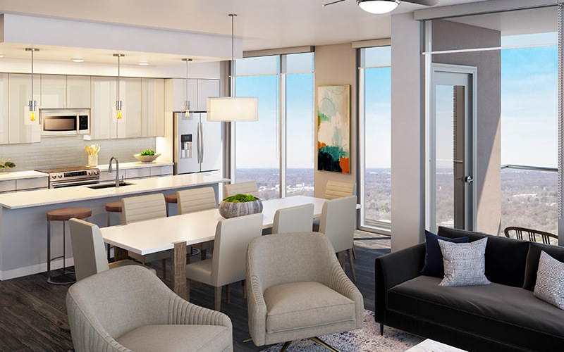 Large living room adjacent to kitchen with floor to ceiling windows and natural lighting